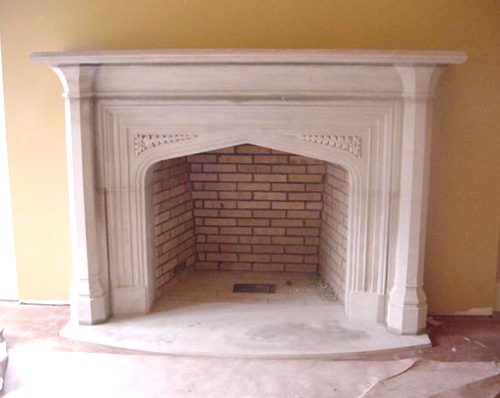 Tudor artisans hand carved limestone fireplaces door for Tudor style fireplace