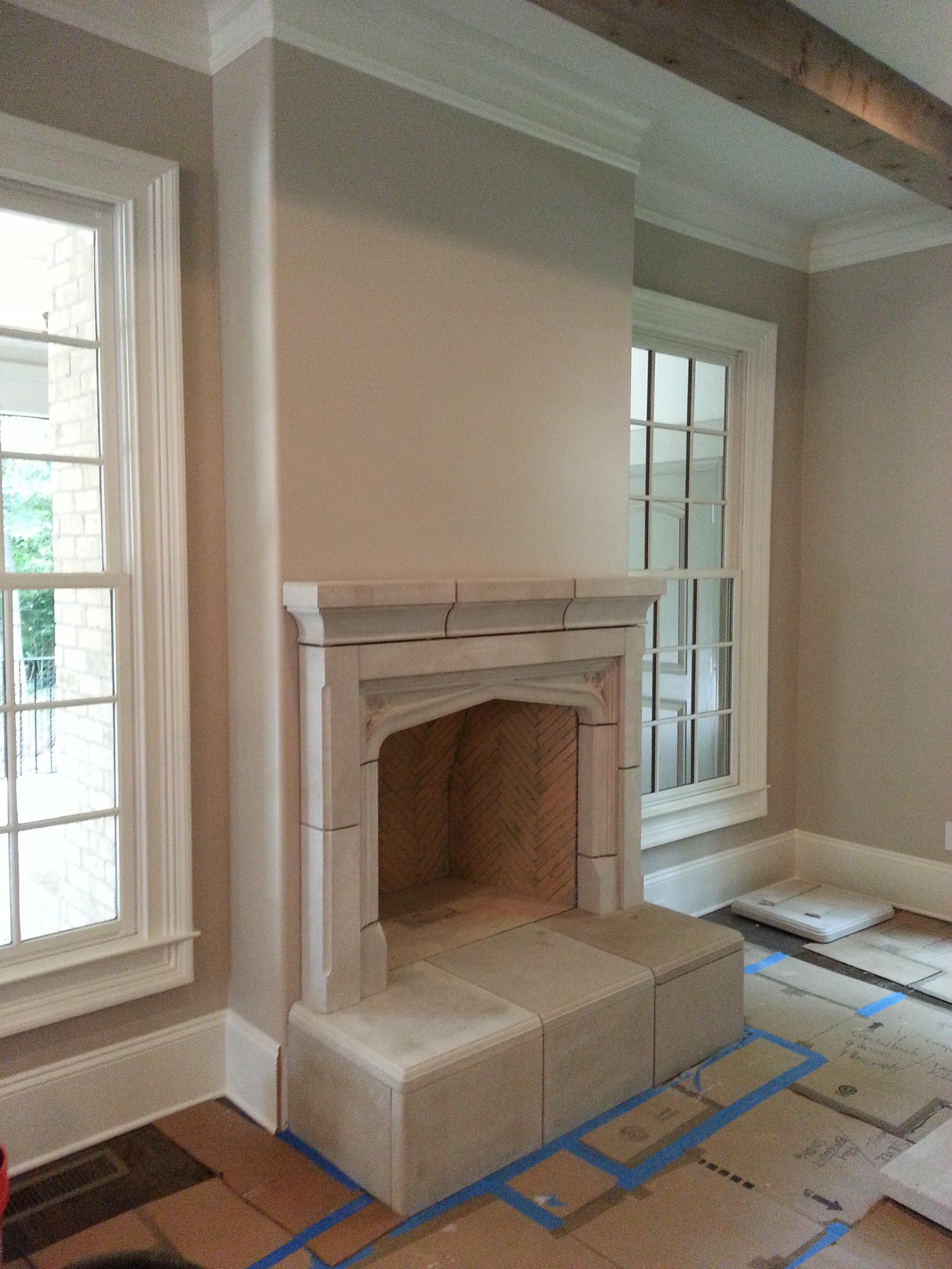 Fireplace Raised Hearth. Example 38  Tudor Limestone Mantle config C scaled smaller than normal to fit application with raised sitting hearth Artisans Fireplaces